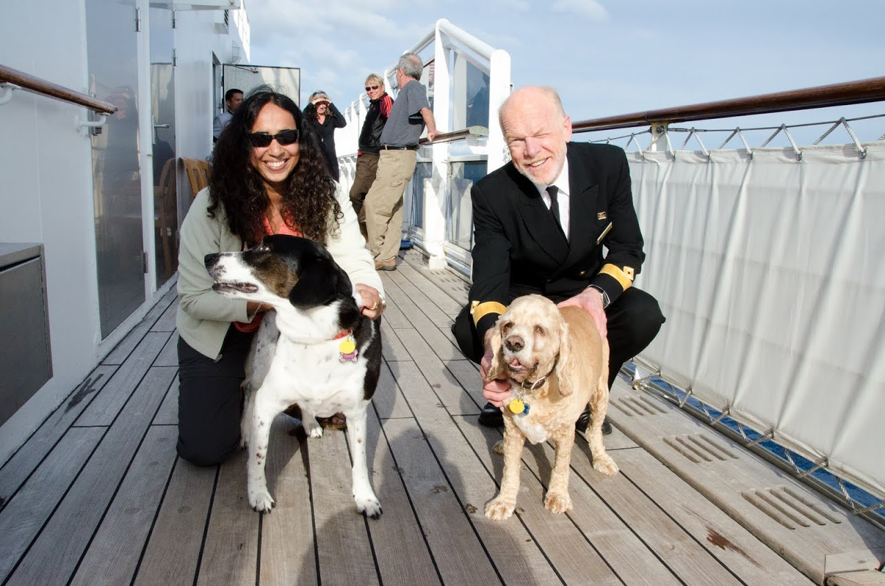 Chewy and Abby and the captain on the QM2